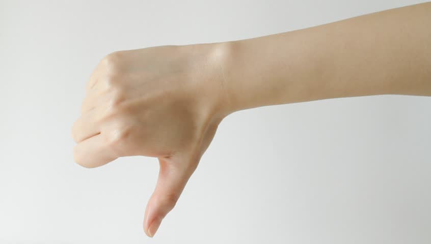 Hand giving thumbs up and down against white background