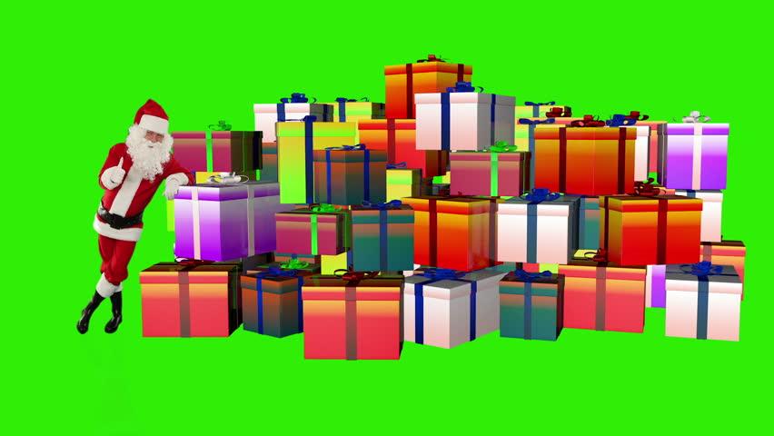 Santa Claus magically piling up gift boxes, Green Screen