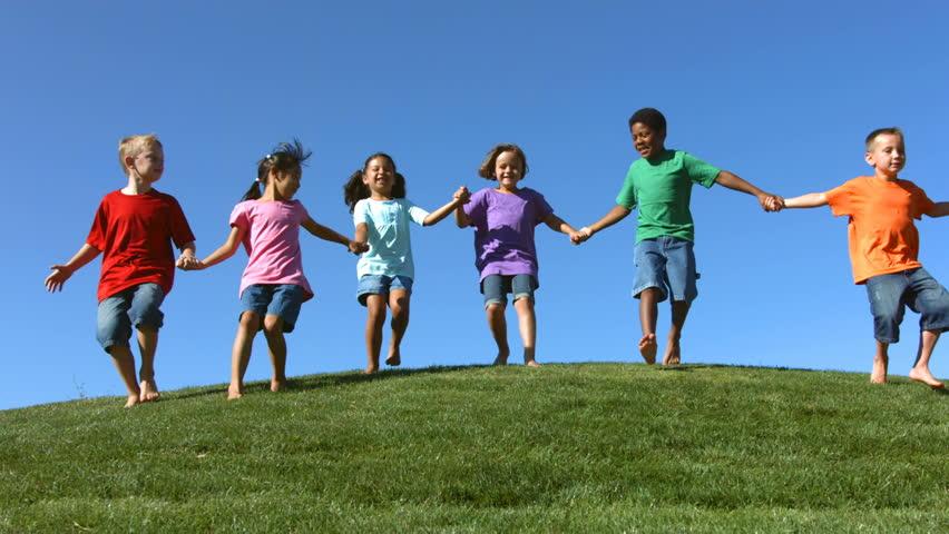 Portrait of children of various ethnicities on a hilltop  | Shutterstock HD Video #4677071