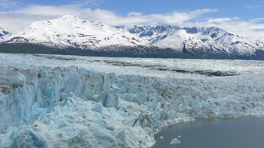 Flying over lake and glacier, Alaska #4686707