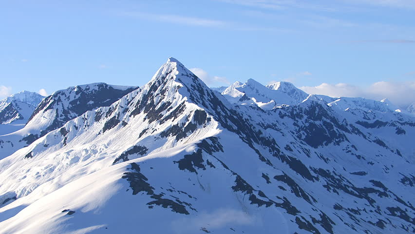 Aerial shot of snowy mountain peak, Alaska | Shutterstock HD Video #4686773