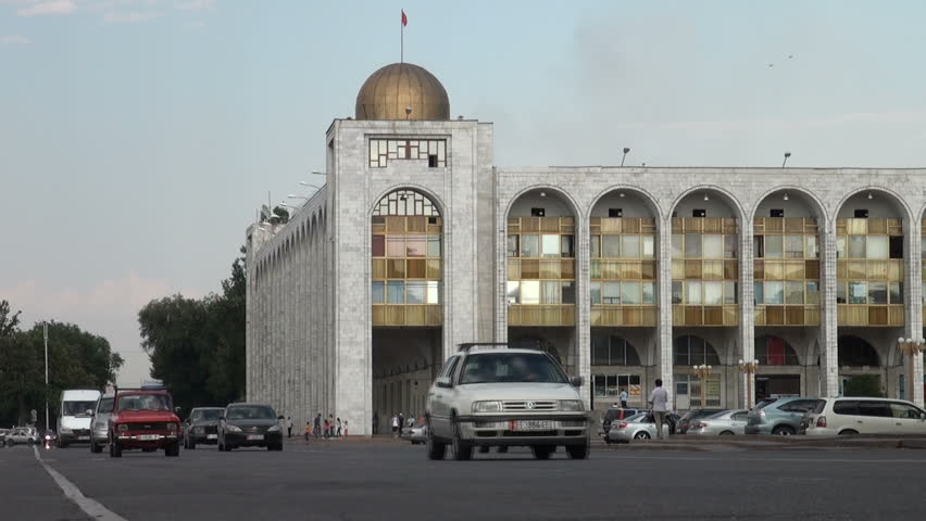 BISHKEK, KYRGYZSTAN - 27 JULY 2013: Traffic makes its way across Bishkek, past the main 'Ala Too' square