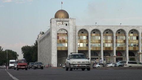 BISHKEK, KYRGYZSTAN - 27 JULY 2013: Traffic makes its way across Bishkek, past the main 'Ala Too' square