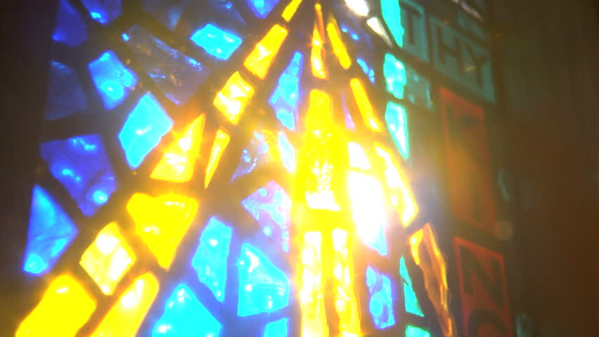 Sun shining through stained glass window