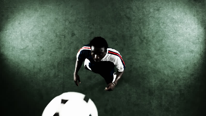 Bird's eye view shot of a soccer player juggling and doing tricks with the ball | Shutterstock HD Video #4706936