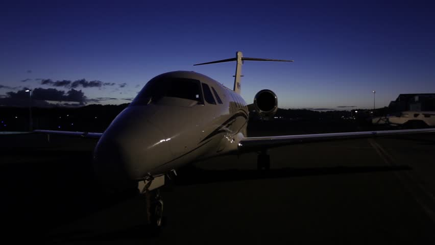 Steadicam shot of a Cessna Citation IV private jet airplane grounded at dusk. Shot on a Canon 5D MK II with a Canon 16-35mm f2.8 zoom lens.