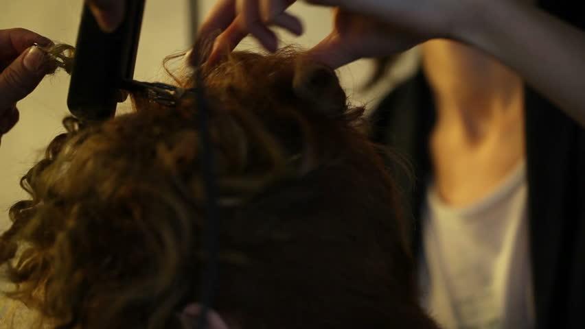 Model having hair styled before shooting