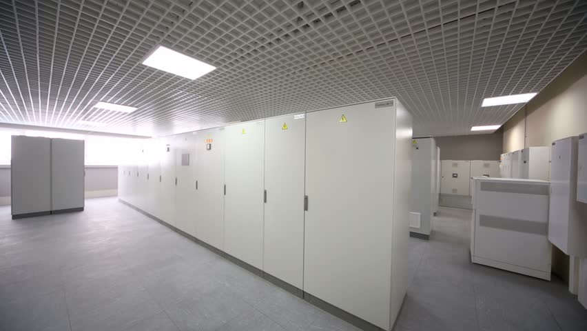 Light switched off and then turns on in room with rows of racks with equipment for telecommunication system