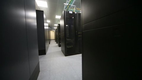 Room of data center with telecommunication racks and cables