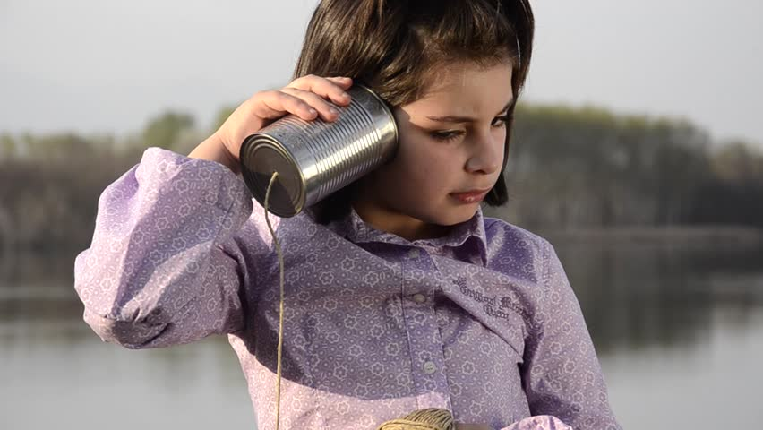 young girl with a funny phone