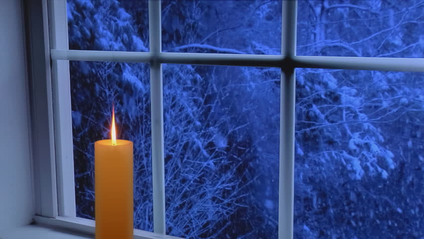 Golden Candle Glows In Front Of Window With Heavy Snow Storm Seen Outside At Night Stock Footage Video 4719272