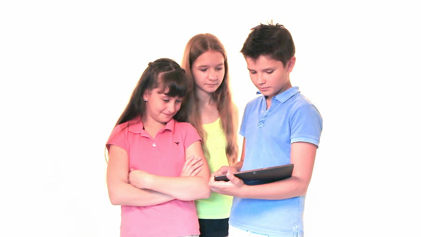 Three Happy Kids Two Girls And One Boy Standing Watching Images On Tablet Computer
