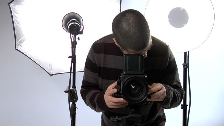 Studio Photographer Stock Footage Video (100% Royalty-free) 4723802 |  Shutterstock