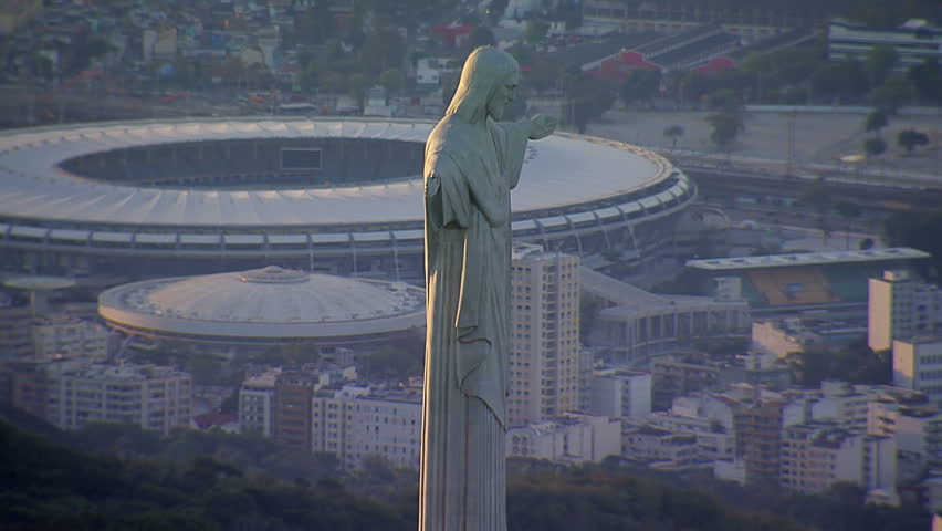 Closeup aerial view of Christ the Redemeer Statue and Maracana Stadium, Rio de Janeiro, Brazil