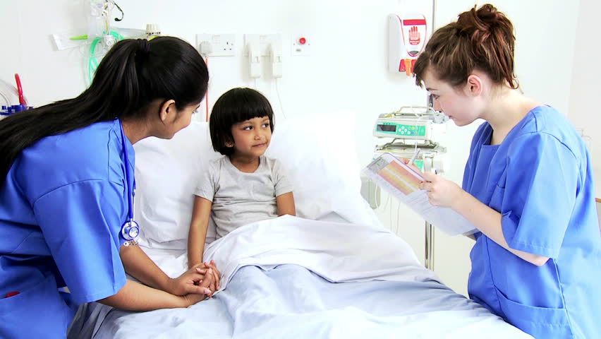 Multi-Ethnic Nursing Staff Comforting A Little Asian Girl -2589