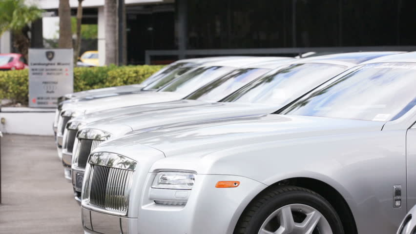 MIAMI - SEPTEMBER 26: Stock footage of Rolls Royce cars for sale. Rolls-Royce Limited is a renowned British car manufacturing company by September 26, 2013 in Miami, USA