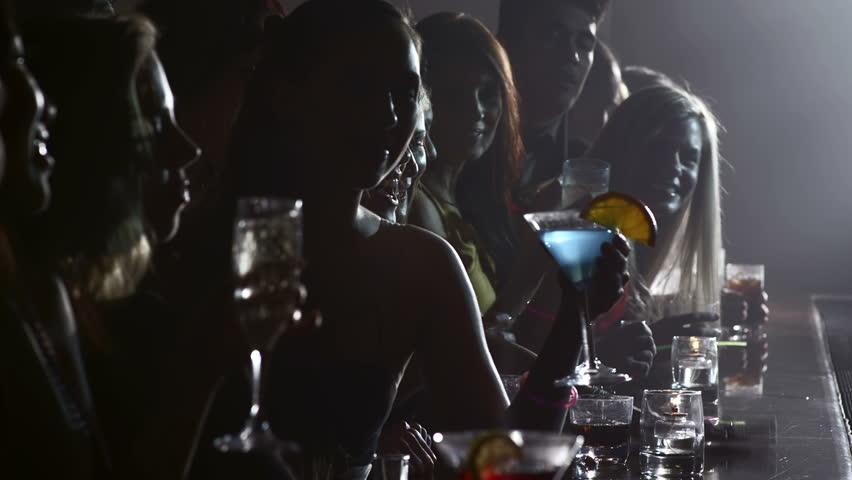 Dark shot of a row of people drinking at a bar | Shutterstock HD Video #4776896
