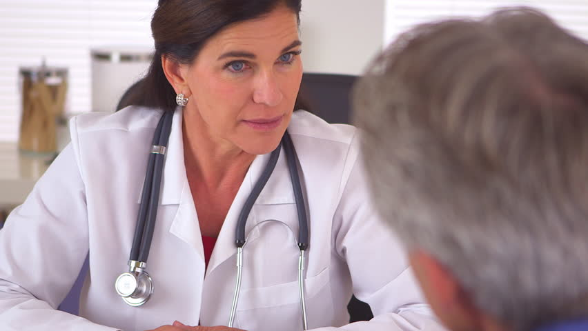Sincere woman doctor advising elderly patient on future steps to recovery | Shutterstock HD Video #4781852
