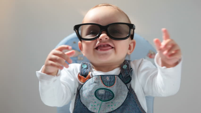 Baby in 3D glasses claps her hands