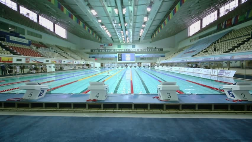 MOSCOW   APR 20: Few People Swim By Track In Pool At Olympic Sports Complex