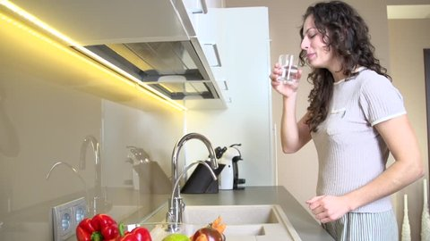 Healthy Young Woman Drinking Fresh Water from the Kitchen Faucet. Healthy Lifestyle Full HD Video Footage