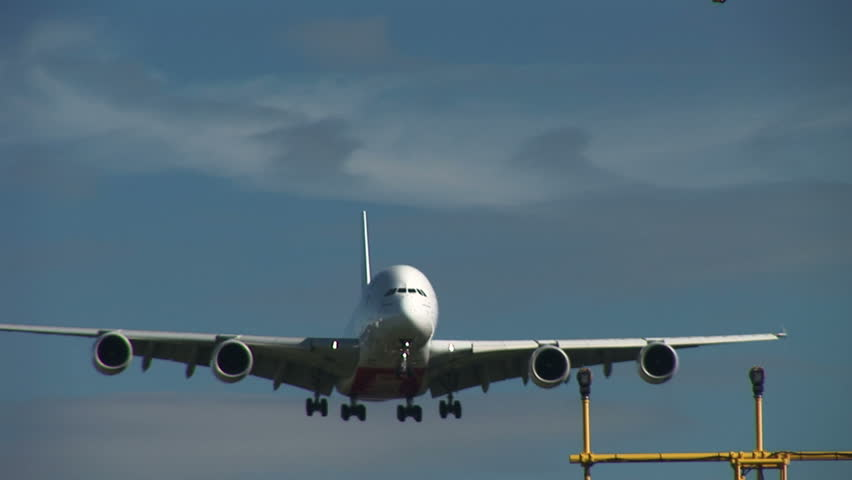 Airbus A380 coming in to land over landing lights