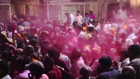 Vrindavan, Mathura District, Uttar Pradesh, India - 03/25/2013 - Pan shot of people celebrating Holi festival at Banke Bihari Temple, Vrindavan, Mathura District, Uttar Pradesh, India