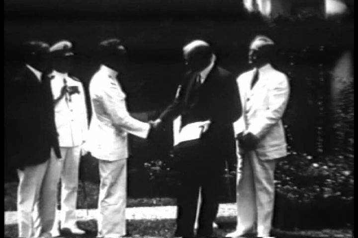 1930s - Admiral Richard Byrd returns from his Antarctic expedition in 1930 and is greeted by Herbert Hoover and Charles Lindberg. | Shutterstock HD Video #4851872