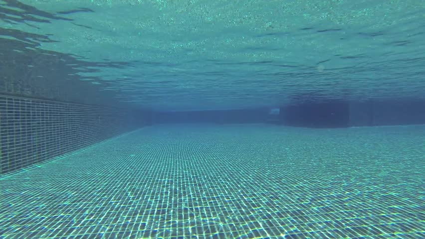 under water inside the swimming pool