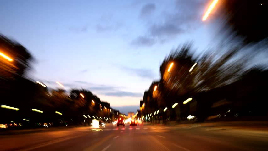Paris - driving shot through city center at night, time lapse Photographic time lapse driving shot through inner city of Paris, passing Eiffel tower, inner city and Champs Elysees. pov.  | Shutterstock HD Video #4862372
