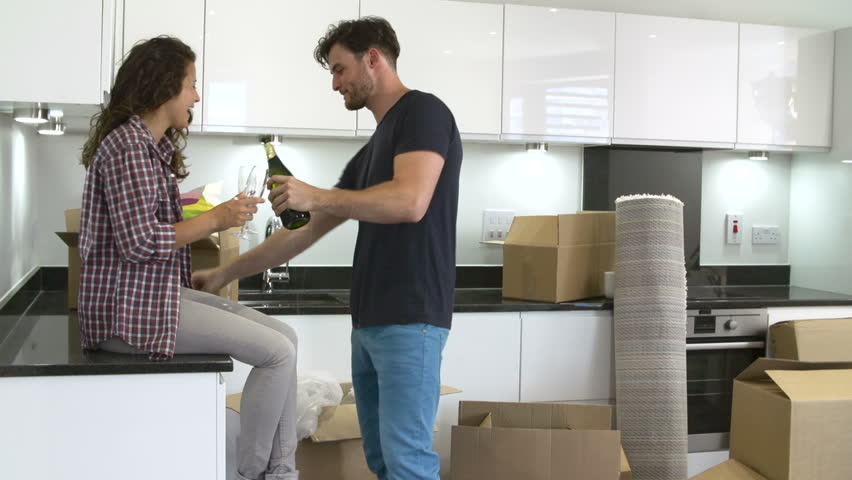 Couple Opens Bottle Of Champagne To Celebrate Moving Into New Home ...