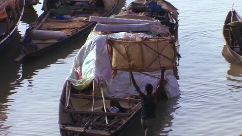MALI-CIRCA 2012-Boats are loaded along the Niger River in mali, Africa.