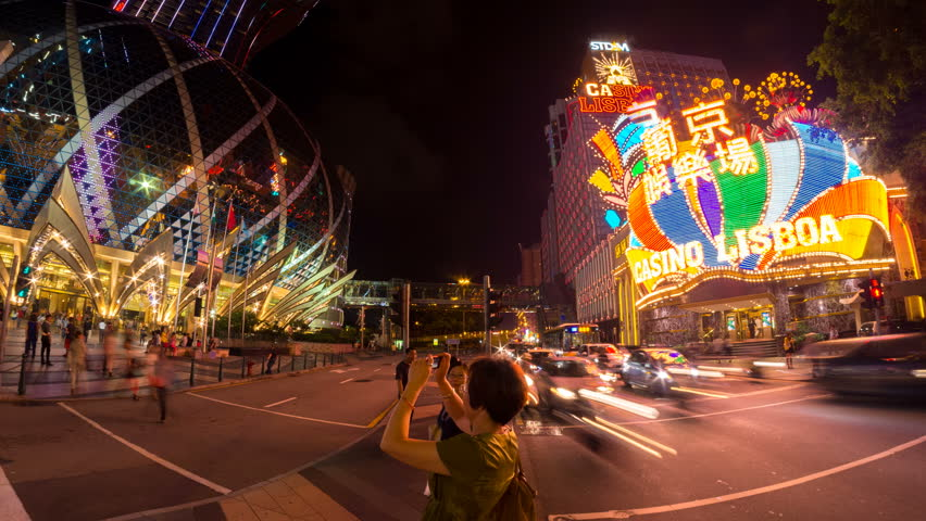 MACAU - 12 SEPT: Timelapse view of the modern Casino district of Macau Peninsula, a former Portugese colonial city and now popular destination for tourism on 12 September 2013 in Macau, China