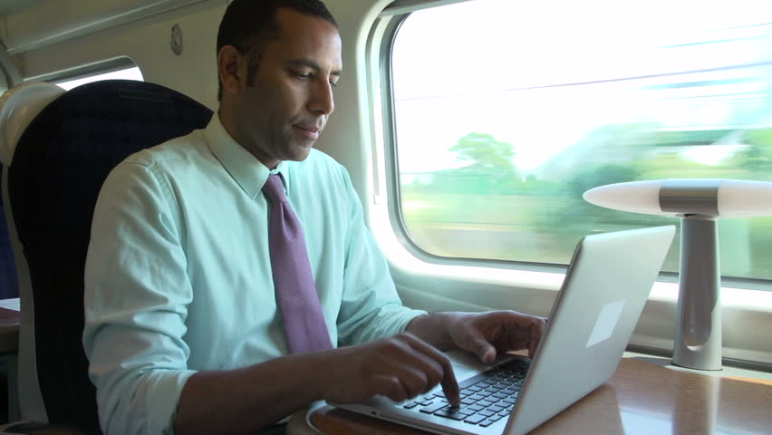 Close view of businessman working on laptop while going on business trip by train | Shutterstock HD Video #4885400