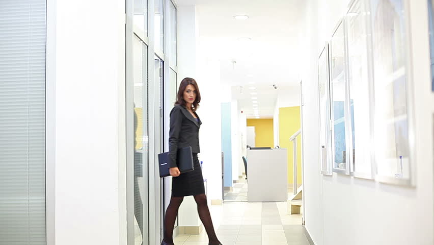 Attractive businesswoman walking through the lobby