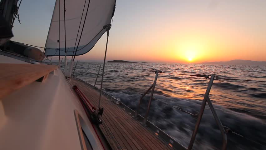 Yacht sailing against sunset. Travel Concept. Sailboat. Luxury yacht. Sailing.