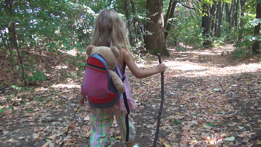 Child, Little Girl Playing, Walking with Bear Toy on Path in Forest, Children