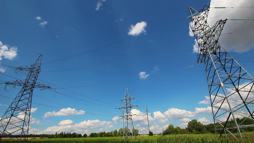 tall electric masts against cloudy sky - timelapse