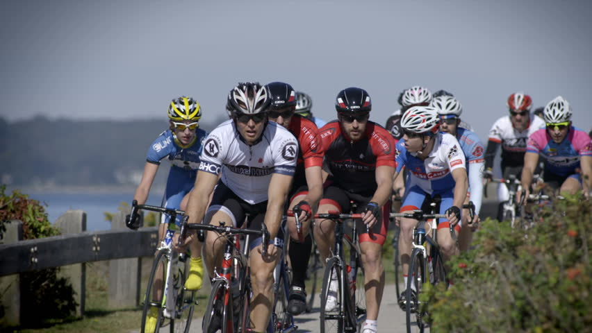JAMESTOWN, RHODE ISLAND – OCTOBER 14: Cyclists in the 38th annual Jamestown Classic road race compete for a winning place on the podium October 14, 2013 in Jamestown, RI.  240fps slow-motion. | Shutterstock HD Video #4928531