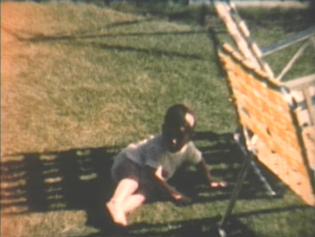 1960s home video of baby crawling down steps with mother, Seattle, Washington.