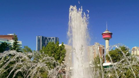 Calgary Tower through the fountain at Central Memorial Park, Canada