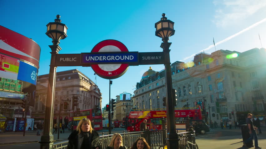 London, October 24, 2013. Entrance to the underground station at Piccadilly Circus during morning rush hour in  in London with double decker buses, London, England, United Kingdom