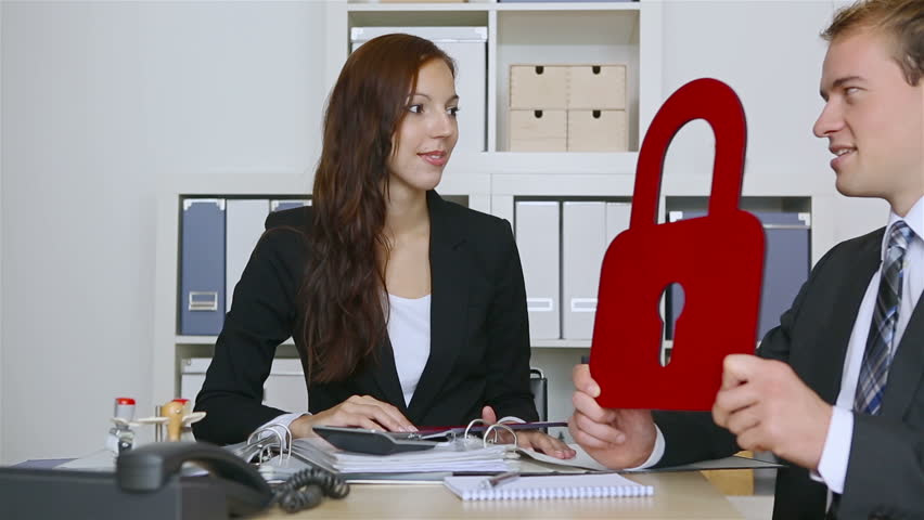 Two business people holding key and lock in the office (Full HD)   Shutterstock HD Video #4961282