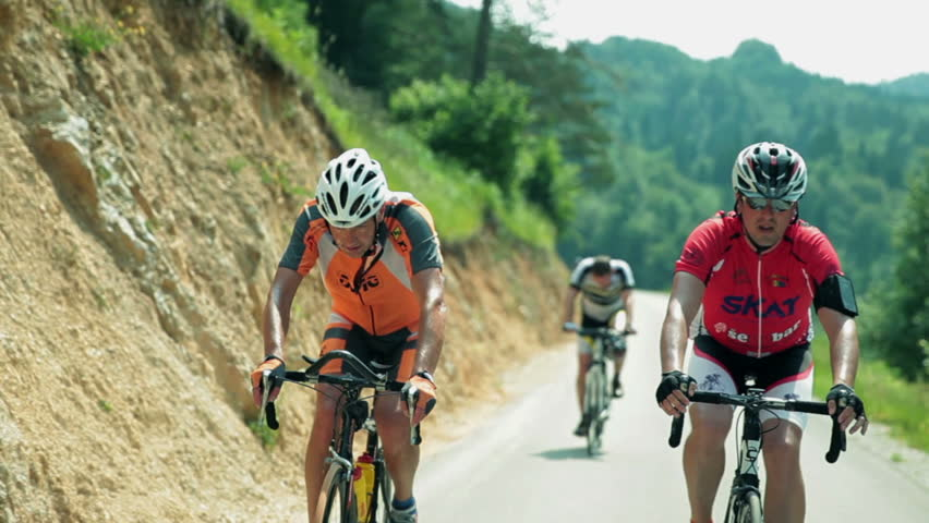 VRHNIKA - AUG 24: Tracking a cyclist through countryside. Bicycle hill climbing competition Argonavtski Maraton Slovenija, Vrhnika 2013.