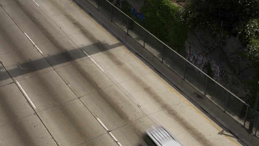 Looking down over cars passing on freeway with graffiti | Shutterstock HD Video #4965722