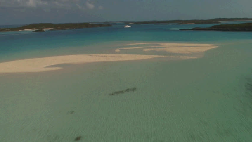 Bahamas land and sea park, low pass over sand bar, over the top of a large yacht.