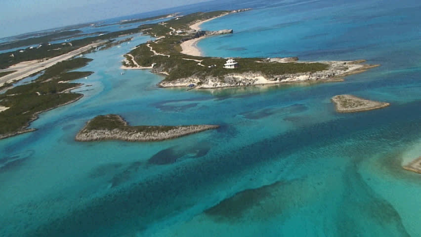 Bahamas, Staniel Cay, Low level aerial dive over beach.