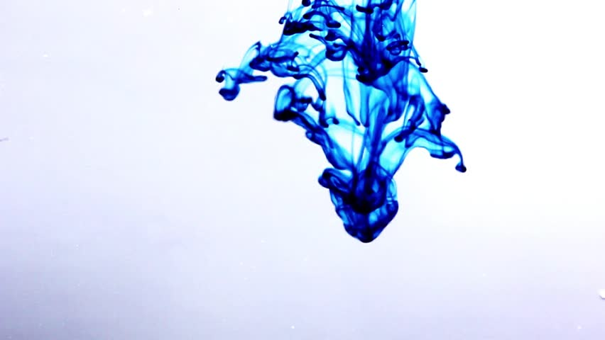 Blue ink drips into clear water from above.