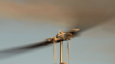 Close-up of a helicopter's rotor blades spinning. We film in Africa's National Parks with permission, contact us for location release.