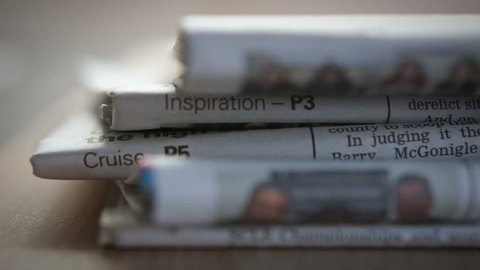 Stack Of Newspapers. A close up dolly of a stack of Newspapers filmed on the Blackmagic Cinema Camera.